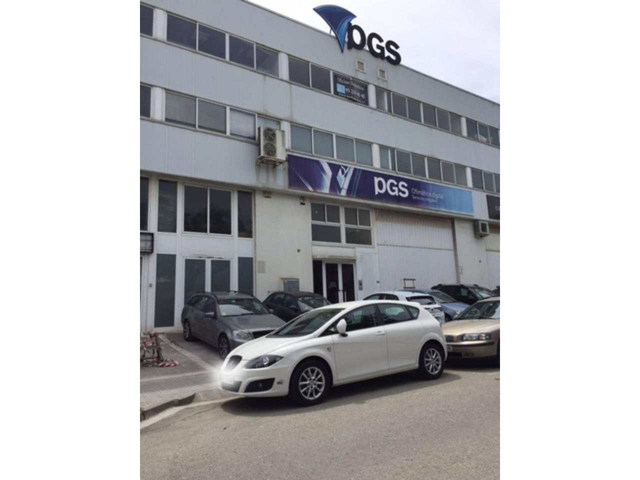 Edificio corporativo, nave y oficinas en L´Eixample-Torreblanca